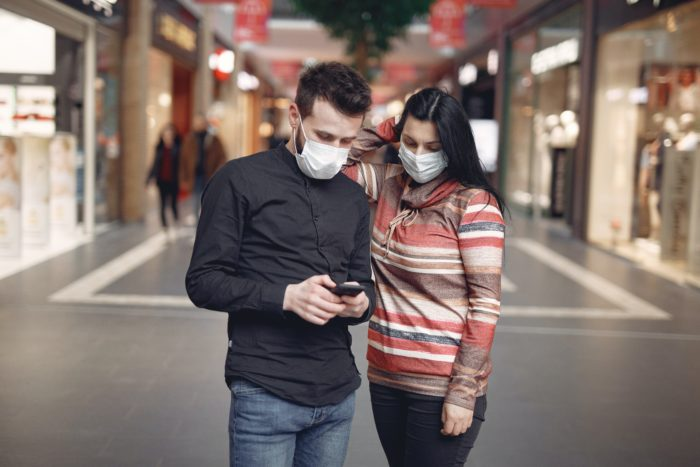 couple on smartphone local search factors